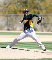 Yadel Marti #70 of the Oakland Athletics pitches a live batting practice session in spring training workouts at the Athletics complex on February 23, 2011  in Phoenix, Arizona. .Photo by:  Bill Mitchell/Four Seam Images.