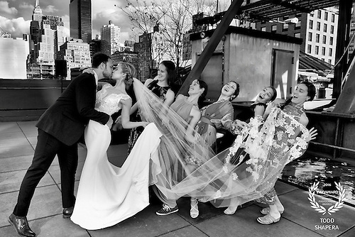 Newlywed's First kiss with bridesmaids on the rooftop of Hudson Mercantile in New York City.