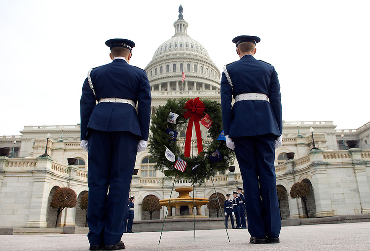 Members of the Civil Air Patrol Honor Guard during a ceremony for the Wreaths Across America on the West Front of the U.S. Capitol. The Wreaths Across America story began over 15 years ago when Worcester Wreath Company (a for-profit commercial business from Harrington, Maine) began a tradition of placing wreaths on the headstones of our Nation's fallen heroes at Arlington National Cemetery.