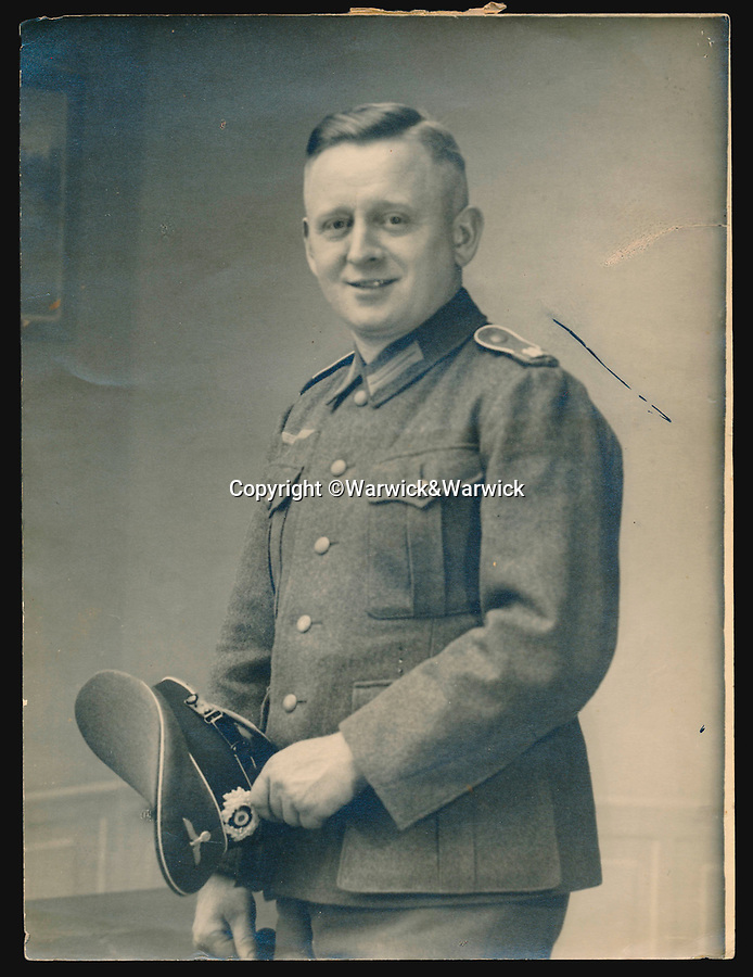 BNPS.co.uk (01202 558833)<br /> Pic: Warwick&Warwick/BNPS<br /> <br /> Colditz photographer Johannes Lange took the photos<br /> <br /> A remarkable archive of photos which provide a glimpse inside the infamous Colditz Castle has come to light.<br /> <br /> The photos show the ingenuity of the Allied POWs who devised ever-bolder ways to escape from the German stronghold during World War Two.<br /> <br /> One image is of a dummy they would hold up to trick the German guards into believing the escaper was still with them during parade head counts. Others reveal the tunnels which were dug using tools smuggled into the 11th century castle in care parcels.<br /> <br /> The photos were taken by the official Colditz photographer Johannes Lange, who was employed by the German Army to take pictures of failed Allied escape attempts. They were then distributed to other POW camps to alert the guards to the methods the inmates were using in their bids for freedom.<br /> <br /> The archive is being sold by a private collector with auctioneer Warwick & Warwick, with an estimate of £1,750.