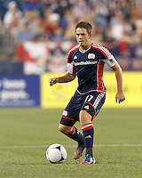 New England Revolution substitute midfielder Kelyn Rowe (11) looks to pass. In a Major League Soccer (MLS) match, Montreal Impact defeated the New England Revolution, 1-0, at Gillette Stadium on August 12, 2012.