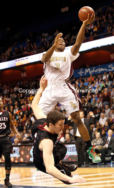 Uncasville, CT- 22 March 2015-032215CM19- Sacred Heart's Mustapha Heron goes to the hoop as Valley Regional's David Bradbury goes to the ground during their Class S state championship game at Mohegan Sun Arena in Uncasville on Sunday.    Christopher Massa Republican-American