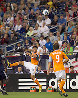 Houston Dynamo forward Brian Ching (25) heads the ball. The New England Revolution defeated Houston Dynamo, 1-0, at Gillette Stadium on August 14, 2010.