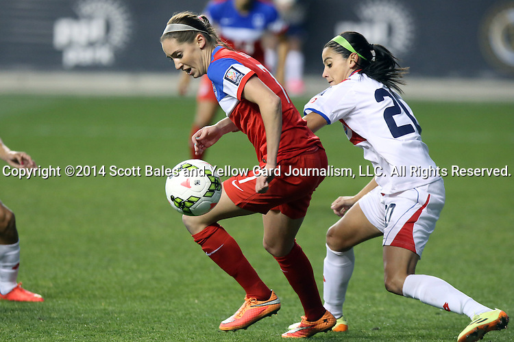 26 October 2014: Morgan Brian (USA) (left) and Wendy Acosta (CRC) (20). The United States Women's National Team played the Costa Rica Women's National Team at PPL Park in Chester, Pennsylvania in the 2014 CONCACAF Women's Championship championship game. By advancing to the final, both teams have qualified for next year's Women's World Cup in Canada. The United States won the game 6-0.