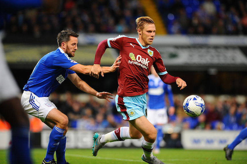 Burnley's Rouwen Hennings (R) holds off Ipswich Town's Cole Skuse<br /> <br /> Photographer Ashley Pickering/CameraSport<br /> <br /> Football - The Football League Sky Bet Championship - Ipswich Town v Burnley - Tuesday 18th August 2015 - Portman Road - Ipswich<br /> <br /> &copy; CameraSport - 43 Linden Ave. Countesthorpe. Leicester. England. LE8 5PG - Tel: +44 (0) 116 277 4147 - admin@camerasport.com - www.camerasport.com
