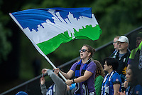 Seattle, WA - Saturday, May 14, 2016: A Seattle Reign FC fan waves a flag during the first half. The Portland Thorns FC and the Seattle Reign FC played to a 1-1 tie during a regular season National Women's Soccer League (NWSL) match at Memorial Stadium.