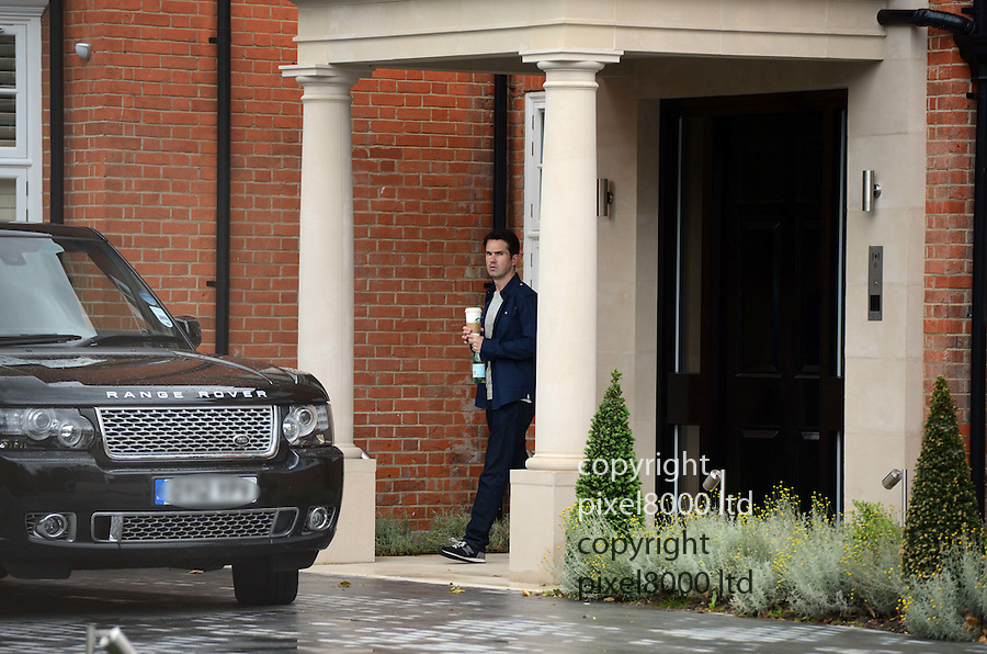 Pic shows: Jimmy Carr leaves his £8.5 million pound home with Range Rover outside. today 22.6.12.with bottle of water and coffee...Pic by Gavin Rodgers/Pixel 8000 Ltd