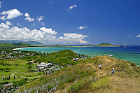Hikers enjoy a spectacular view of Kailua Bay and Lanikai beach from the Lanikai ridge trail.Windward Oahu.