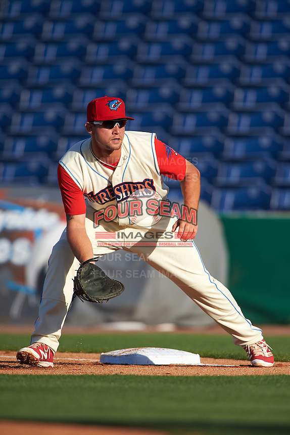 Clearwater Threshers first baseman Kyle Martin (27) holds a runner on during a game against the Dunedin Blue Jays on April 8, 2016 at Bright House Field in Clearwater, Florida.  Dunedin defeated Clearwater 8-3.  (Mike Janes/Four Seam Images)