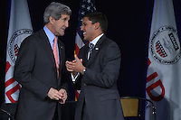 February 15, 2013  (Washington, DC)  U.S. Secretary of State John Kerry (l) and USAID Administrator Rajiv Shah at the Ronald Reagan Building in Washington. Kerry addressed USAID employees for the first time as Secretary. (Photo by Don Baxter/Media Images International)