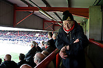 Brentford 0 Doncaster Rovers 1, 27/04/2013. Griffin Park, League One. Griffin Park hosts a showdown between two clubs aiming for automatic promotion from League One. A Doncaster supporter checks his watch as his side near promotion to the Championship. Photo by Simon Gill.