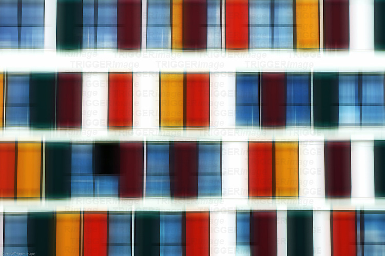 The abstract photograph of a facade with symmetrically arranged windows.