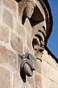 16/06/14 - LA GODIVELLE - PUY DE DOME - FRANCE -Gargouille representant un cochon tenant un fromage sur l eglise de La Godivelle -Photo Jerome CHABANNE