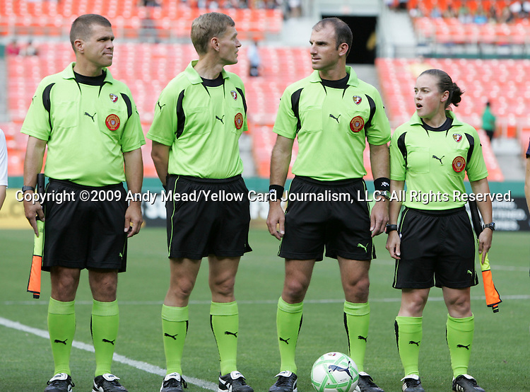 18 July 2009: Match Officials. From left: Assistant Referee John Schmitz, Fourth Official Bryan Roslund, Referee Ted Unkel, Assistant Referee Moo Hackett. The Washington Freedom defeated Saint Louis Athletica 1-0 at the RFK Stadium in Washington, DC in a regular season Women's Professional Soccer game.