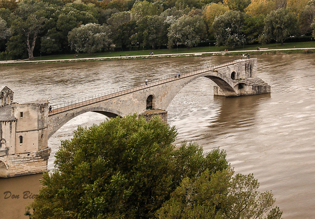 The world-famous bridge in Avignon France is officially called &quot;Pont St. Benezet&quot;.   <br /> The bridge, built in the 12th century, once spanned the beautiful Rhone River.  Much of it was washed away by flooding over the centuries, however, four of the original 22 arches still remain.