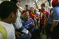 United States fans marching to Azteca stadium from the Zona Rosa District of Mexico City share some laughs with Mexican fans aboard a Metro subway train. The United States Men's National Team played Mexico in a CONCACAF World Cup Qualifier match at Azteca Stadium in, Mexico City, Mexico on Wednesday, August 12, 2009.