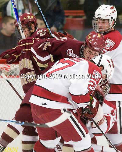 Cam Atkinson (BC - 13), Pat Mullane (BC - 11), Michael Biega (Harvard - 27) - The Boston College Eagles defeated the Harvard University Crimson 3-2 on Wednesday, December 9, 2009, at Bright Hockey Center in Cambridge, Massachusetts.