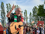 The Rev. Jorge Rodriguez, a United Methodist pastor, leads participants in song at a rally outside a federal detention center in Sheridan, Oregon. Participants protested the Trump administration's policy of separating parents from their children at the U.S.-Mexico border.