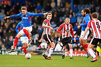 Ronan Curtis of Portsmouth gets airborne during Portsmouth vs Altrincham, Emirates FA Cup Football at Fratton Park on 30th November 2019