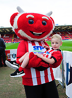 Lincoln City mascot Poacher the Imp with a young fan<br /> <br /> Photographer Chris Vaughan/CameraSport<br /> <br /> The Carabao Cup Second Round - Lincoln City v Everton - Wednesday 28th August 2019 - Sincil Bank - Lincoln<br />  <br /> World Copyright © 2019 CameraSport. All rights reserved. 43 Linden Ave. Countesthorpe. Leicester. England. LE8 5PG - Tel: +44 (0) 116 277 4147 - admin@camerasport.com - www.camerasport.com