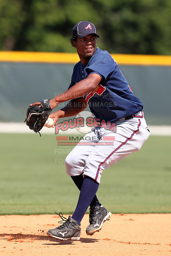 Atlanta Braves third baseman Edward Salcedo #33 during warmups before an Instructional League game against the Pittsburgh Pirates at Pirate City on October 14, 2011 in Bradenton, Florida.  (Mike Janes/Four Seam Images)