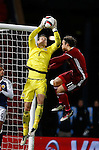 Craig Gordon of Scotland collects the ball under pressure from Erik Sviatchenko of Denmark during the Vauxhall International Challenge Match match at Hampden Park Stadium. Photo credit should read: Simon Bellis/Sportimage