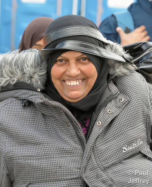 A refugee woman walks across the border into Austria near the Hungarian town of Hegyeshalom. Hundreds of thousands of refugees and migrants flowed through Hungary in 2015, on their way to western Europe from Syria, Iraq and other countries. The ACT Alliance has provided food and other critical support for refugee and migrant families here and in other places along their journey.