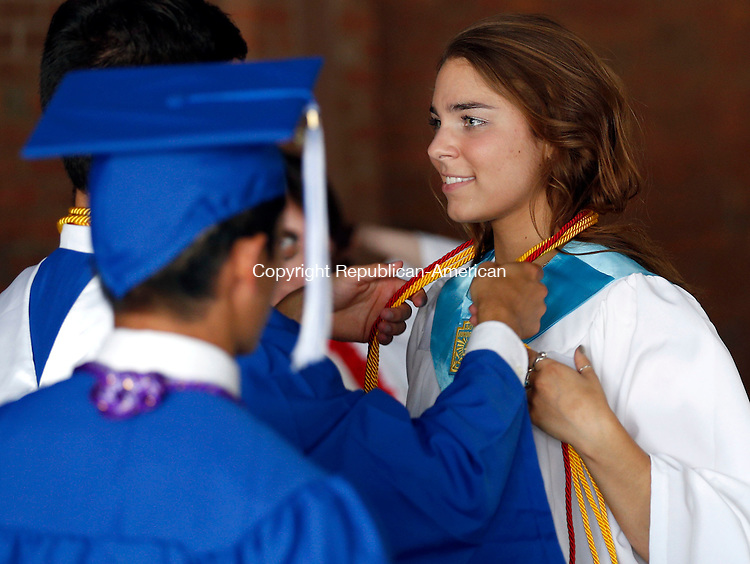 Torrington, CT- 22 June 2015-062215CM01-  Lewis Mills graduate Alyssa Pilkington gets ready to graduate with fellow classmates before the start of commencement exercises at The Warner Theatre in Torrington on Monday.  Christopher Massa Republican-American