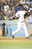 06/06/13 Los Angeles, CA: Los Angeles Dodgers right fielder Yasiel Puig #66 hits a grand slam in the eighth inning giving the Dodgers a 5-0 Victory over the Atlanta Braves.