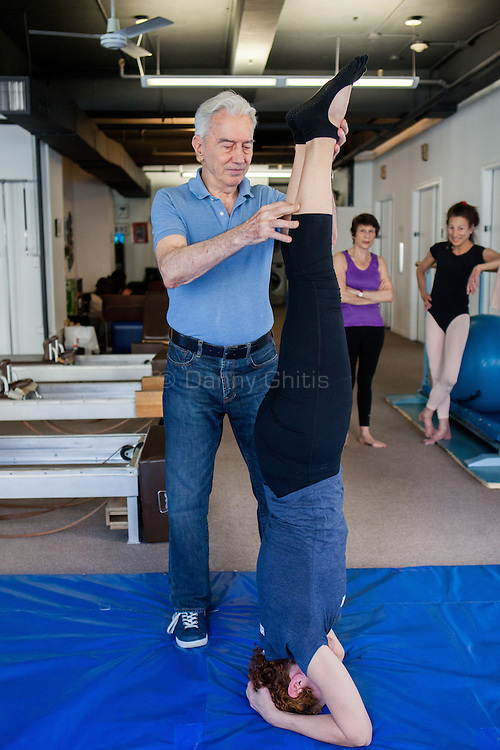 Ivo Lupis, 84, has been working as a personal trainer on 57th St since 1967. His recently client age spans from ages 4-93, though he now mostly works with seniors. Pictured, Vivian Piccone Jung doing a headstand.