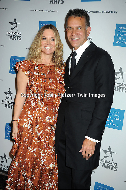 Maria Bell and Brian Stokes Mitchell attend the Americans for the Arts 2012 National Arts Awards on October 15, 2012 at Cipriani 42nd Street  in New York City.