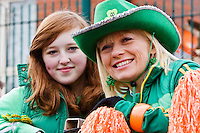 St Patrick's Day parade High Street Digbeth.Two generations (mother and daughter?) on Parade float Camp Hill Bordesley