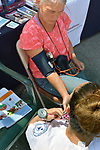 Marlena Marallo, of Arm-of-the-Sea Theater, has her Blood pressure taken by Ulster BOCES LPN Student, Nikki Boice, as part of the Health Alliance Group's participation in Health Day theme, at the Saugerties Farmer's Market on Main Street in the Village of Saugerties, NY, on Saturday, June 10, 2017. Photo by Jim Peppler. Copyright/Jim Peppler-2017.