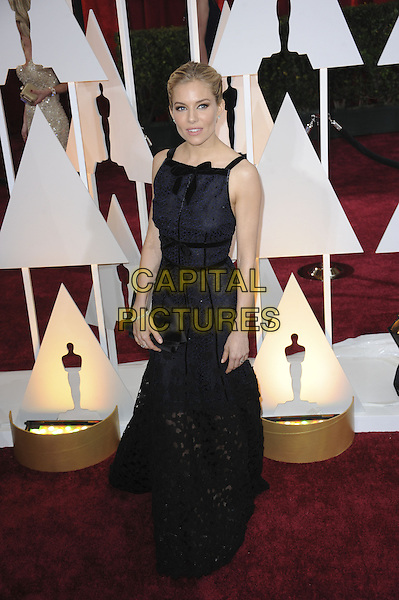 HOLLYWOOD, CA - FEBRUARY 22: Sienna Miller attends 87th Annual Academy Awards at The Dolby Theater on February 22nd, 2015 in Hollywood, California. <br /> CAP/MPI/PGMP<br /> &copy;PGMP/MPI/Capital Pictures