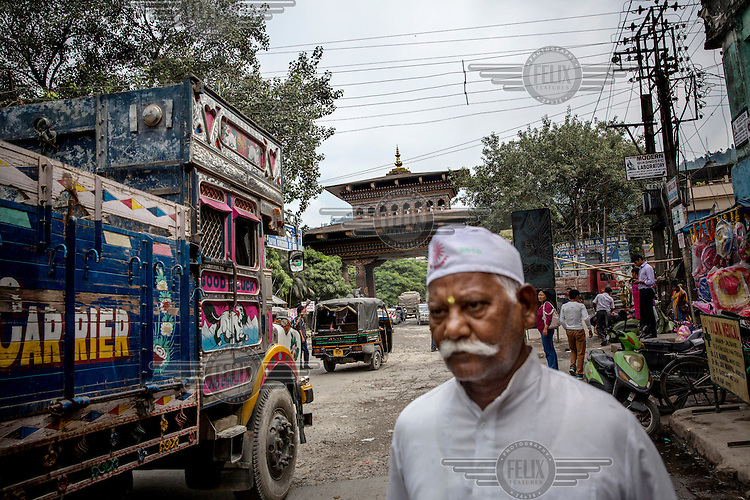 Trucks and people cross through the Buthan gate which marks the border point between India and Bhutan and is one of the main smuggling routes for tiger parts trafficked between India and China.