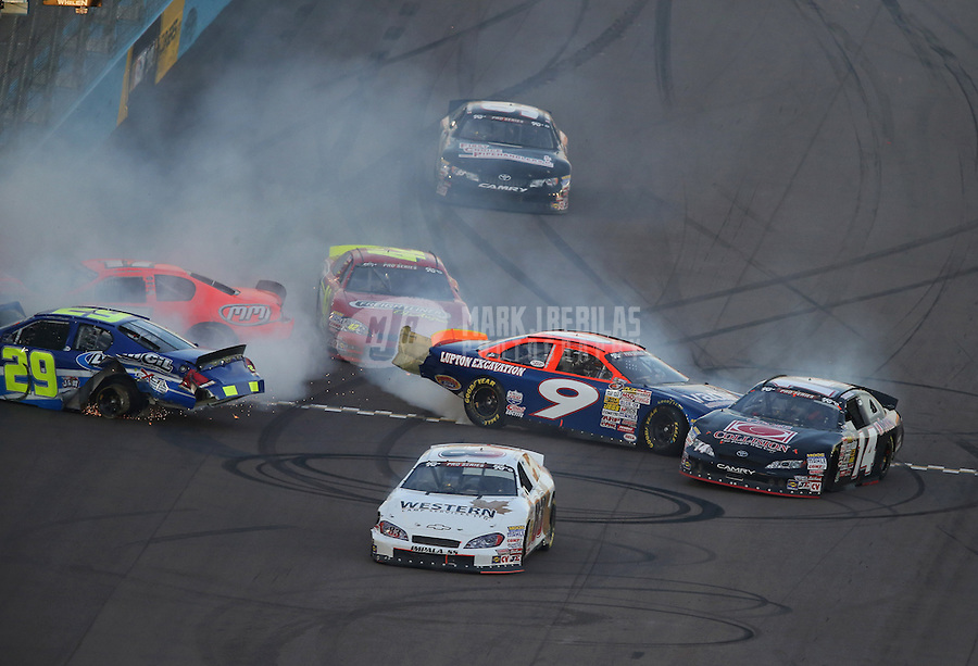 Mar. 2, 2013; Avondale, AZ, USA; NASCAR K&N Pro Series West drivers Dallas Montes (29), David Mayhew (17), Travis Milburn (14) and Dylan Lupton (9) crash during the Talking Stick Resort 60 at Phoenix International Raceway. Mandatory Credit: Mark J. Rebilas-