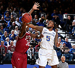 BROOKINGS, SD - JANUARY 13: David Jenkins Jr. #5 from South Dakota State University takes the ball to the basket against Abiola Akintola #32 from Denver during their game Saturday afternoon at Frost Arena in Brookings, SD.  (Photo by Dave Eggen/Inertia)
