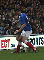 Lee Wallace pressures Danny Carmichael in the Rangers v Queen of the South Quarter Final match in the Ramsdens Cup played at Ibrox Stadium, Glasgow on 18.9.12.