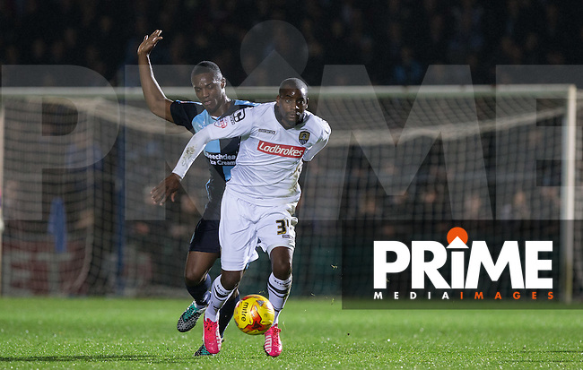 Izale McLeod of Notts County holds off Anthony Stewart of Wycombe Wanderers during the Sky Bet League 2 match between Wycombe Wanderers and Notts County at Adams Park, High Wycombe, England on 15 December 2015. Photo by Andy Rowland.