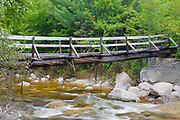 Thoreau Falls Trail bridge days after Tropical Storm Irene in 2011. This bridge crosses the East Branch of the Pemigewasset River at North Fork Junction in the Pemigewasset Wilderness of New Hampshire. This scene shows some of the damage done to the bridge during Tropical Storm Irene.