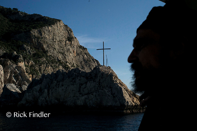 Mount Athos - The Holy Mountain.<br /> A monk looks toward the headland of Mount Athos from the ferry boat. <br /> Photographer: Rick Findler