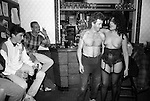 Builder in local pub with Strip o Gram girl given as a birthday present from colleagues who are watching. South London 1991