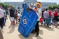 San Francisco, CA - Sunday, July 13, 2014: A Germany fan packs up his planet after the game. Thousands of fans gathered for a public viewing at the Civic Center to watch Germany vs Argentina in the finals of the World Cup.