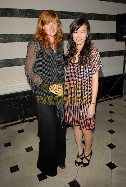 KATIE ALCOTT & KATIE LEUNG.The Grazia O2 Awards, Sunbeam Studio, London, .England, July 19th 2007. .full length black dress circles discs studs studded shiny silver black strappy shoes.CAP/FIN.©Steve Finn/Capital Pictures.