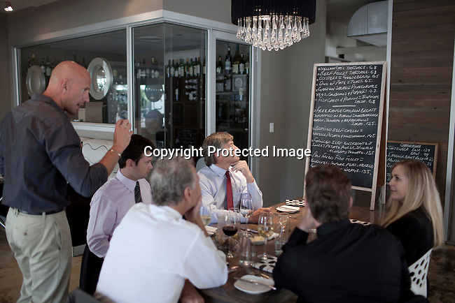 CAPE TOWN, SOUTH AFRICA - MARCH 22: Manager Raphael talks to guests at bizerca bistro on March 22, 2012 in Cape Town, South Africa (Photo by Per-Anders Pettersson For Le Monde)