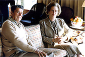 United States President Ronald Reagan, left, confers with Prime Minister Margaret Thatcher of the United Kingdom, right, at Camp David near Thurmont, Maryland on Saturday, December 22, 1984.  Thatcher died from a stroke at 87 on Monday, April 8, 2013..Credit: Mary Anne Fackelman-White House via CNP
