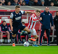 11th January 2020; Bet365 Stadium, Stoke, Staffordshire, England; English Championship Football, Stoke City versus Milwall FC; Shaun Hutchinson of Millwall tackles James McClean of Stoke City - Strictly Editorial Use Only. No use with unauthorized audio, video, data, fixture lists, club/league logos or 'live' services. Online in-match use limited to 120 images, no video emulation. No use in betting, games or single club/league/player publications