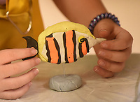 NWA Democrat-Gazette/FLIP PUTTHOFF <br /> An Art Camp student shows her finished tropical fish on Wednesday June 5 2019 at the camp.