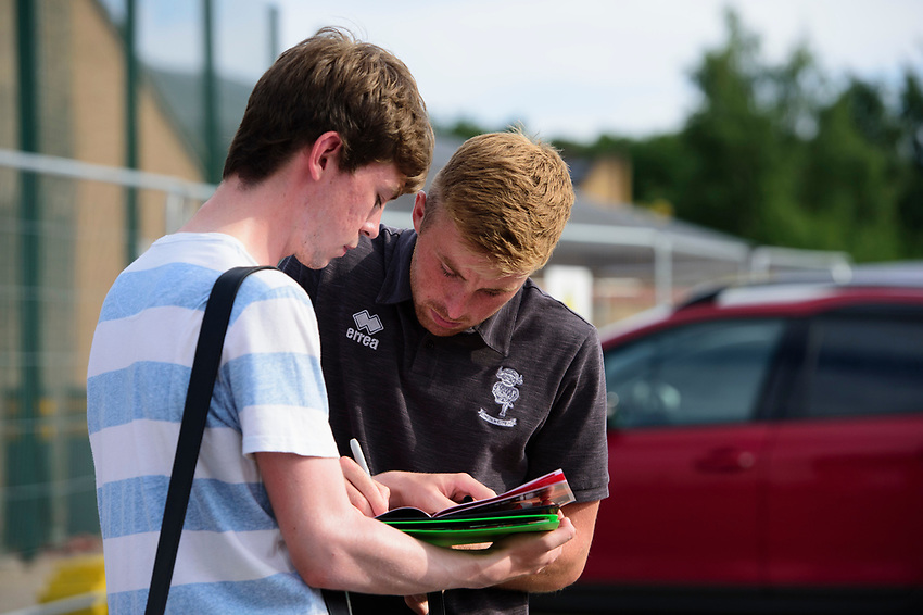 Lincoln City's Joe Morrell signs autographs for fans after arriving at the ground<br /> <br /> Photographer Chris Vaughan/CameraSport<br /> <br /> Football Pre-Season Friendly - Lincoln City v Stoke City - Wednesday July 24th 2019 - Sincil Bank - Lincoln<br /> <br /> World Copyright © 2019 CameraSport. All rights reserved. 43 Linden Ave. Countesthorpe. Leicester. England. LE8 5PG - Tel: +44 (0) 116 277 4147 - admin@camerasport.com - www.camerasport.com