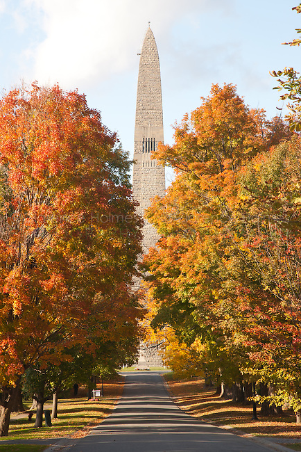 The Bennington Battle Monument and fall foliage along Monument Avenue in Bennington, Vermont